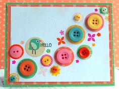 """Buttons, bits and a little bird convey the seeds that help start spring!""...Card by Sabrina Alery"