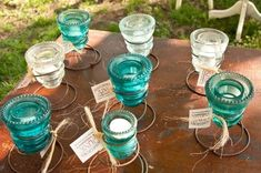 Old mattress springs with glass insulators to make candle holders