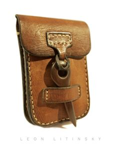 Leather With Wood Accent Pouch Bag by Leon Litinsky.