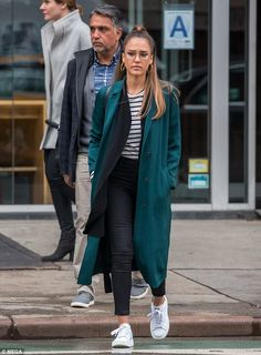 A working lunch: Jessica Alba proved she was a daddy's girl at heart as she grabbed to bit...