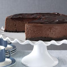 """3D Chocolate Cheesecake Recipe -A cheesecake that is deep, dark and decadent earns the right to be called """"3D."""" This version always looks its chocolate best, because the ganache coating blankets any cracks you may experience, as cheesecakes sometimes like to show. —Vanassa Hicks, Flint, Michigan Chocolate Desserts, Chocolate Cheesecake Recipes, Decadent Chocolate, Melting Chocolate, Chocolate Lovers, Tiramisu Cheesecake, Cheesecake Desserts, German Chocolate, Chocolate Cookies"""