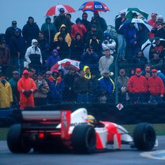 On this day in 1993. European Grand Prix, Donnington Park. Fans watch on as Ayrton Senna arguably drives the finest single lap in F1 history. Despite the torrential conditions, and slipping to the fifth at the start - he completed the lap in first place - passing Michael Schumacher, Karl Wendlinger, Damon Hill and Alain Prost. #F1 #AyrtonSenna #Genius #McLaren #Masterclass #autosport