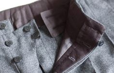 """Detail of bespoke Sartoria Pino Peluso trousers. The """"floating"""" button visible on the far right of the lower picture slots into an invisible buttonhole in the waistband of the trousers."""