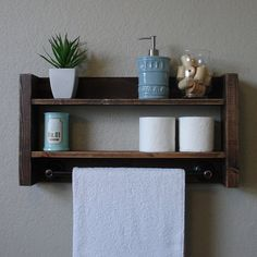 Handcrafted 2 tier bathroom shelf with dark bronze towel bar. Perfect for any home bathroom or apartment.  Made from solid wood. It has been sanded