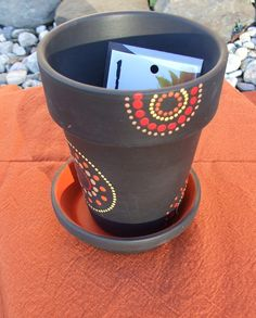 Inspiration for painting pots reminding me using 1/2 the design on edges adds a good look