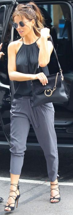 Who made Kate Beckinsale's round sunglasses, black suede handbag, and lace up sandals?