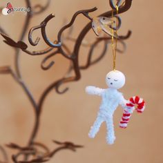 Snowman and candy cane Christmas ornament. A cute craft idea for the Holidays. Materials: pipe cleaners and spun cotton balls.