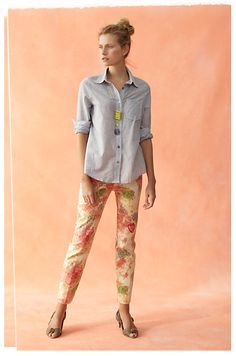 The best way to pull off floral pants - basic chambray or button-down with cute heels. The tribal necklace is a great way to modernize the outfit and prevent it from being too cliche.