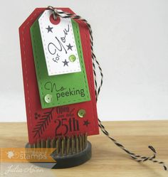 Create With Me:A three layer Christmas tag using stamps and dies from Waltzingmouse.  There are more stampings underneath each tag!