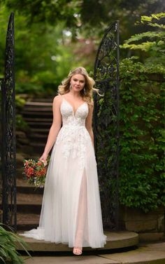 Talk about sheer radiance! This breathtaking wedding dress from Essense of Australia offers a little mystery and a whole lot of magic for the romantic and sexy bride-to-be. Boho Wedding Dress, Designer Wedding Dresses, Bridal Dresses, Wedding Gowns, Wedding Beach, Boho Dress, Garden Wedding, Summer Wedding, Lace Wedding