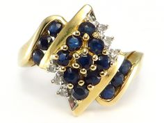 Gorgeous Blue Sapphires and White Diamonds.   1.65ctw round, genuine Sapphires accented by .06 ctw of round, genuine Diamonds set in solid 10k Yellow Gold.  http://donnatsjewelry.com/Gold-Rings-Gemstone-Rings/c64_70/p4543/Sapphire-&-Diamond-Cocktail-Ring-10k-yellow-gold/product_info.html #sapphire and diamonds #gold cocktail rings #donnatsjewelry #holiday sale
