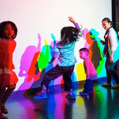 Visitors interact with the Colored Shadows exhibit. Interactive Exhibition, Interactive Walls, Interactive Installation, Chaos Magic, Light Art Installation, Space Museum, Shadow Art, Museum Exhibition, Experiential