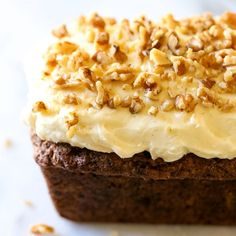 Carrot Walnut Loaf with Cream Cheese frosting is simple, moist, tender, and delicious. It& the perfect sweet recipe for spring! Carrot And Walnut Cake, Carrot Cake Loaf, Carrot Cakes, Frosting Recipes, Cake Recipes, Dessert Recipes, Bread Recipes, Pastries Recipes, Dessert Bread