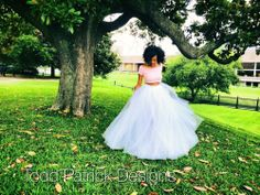 Model is wearing the floor length all white tulle skirt. Can be purchased at www.toddpatrickdesigns.com