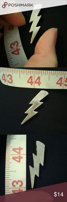 """Vintage 80's Lightning bolt pendant Vintage 80's Silver metal lightning bolt slide??  pendant. One side is smooth with slight tarnish, reverse side is brushed finish. 1 3/8"""" long X 3/8"""" wide. Hole is almost 1/8"""" diameter. Jewelry Necklaces"""