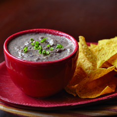 Make this great take-along appetizer up to two days ahead, and then pop it in the microwave when you get to your entertaining destination. Thick corn tortilla chips make the perfect dipper.- Visit PaneraBread.com for more inspiration.