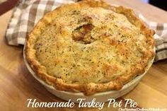 """Turkey Pot Pie from leftovers (my version) - the family loved it! Gotta love it when my experiments work!   2 potatoes diced into 1 inch cubes 1 c. carrots sliced 1/2 med. onion, diced 1 c. Celery, sliced 2 c. Turkey, shredded and torn to < 2"""" long  2 c leftover gravy  1 reg. can cream of chicken soup 2 cans refrigerated crescent roll dough Spices to taste: Salt, pepper, parsley, basil, marjoram, garlic, thyme   Preheat oven to 375 degrees F. In two small round pie tins add half of one can…"""