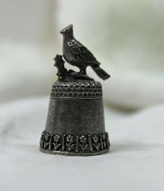 Very cute Pewter thimble adorned with a perching bird
