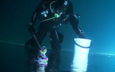 A video shot under the ice of a lake in Finland appears to show divers walking and fishing under the water, that is until you see air bubbles travelling downwards.