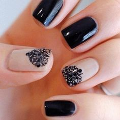 Black nails with one tan nail that has a cute design(: