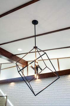 This distinctive chandelier suspended above the coffee table is an ideal complement for the living room's modern furnishings.