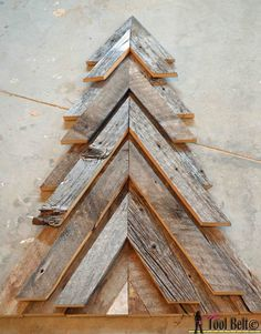 Rustic Christmas Tree - Her Tool Belt : An easy way to add natural elements into your Christmas decor, build a rustic Christmas Tree from pallets or barn wood. Pallet Wood Christmas Tree, How To Make Christmas Tree, Christmas Wood Crafts, Rustic Christmas, Christmas Projects, Christmas Crafts, Christmas Decorations, Christmas Ideas, Christmas Ornament
