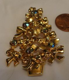"Here is a wonderfully sparkly and flashy Vintage Brooch marked Avon. It is goldtone and has AB Rhinestones and Bowes. It is 2.5""inches in height and 1.5""inches in width. Thank you for visiting and please come again. 