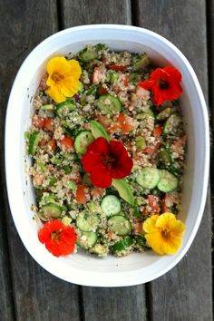 Mediterranean style quinoa salad garnished with edible nasturtiums.  : ~ 2 cups cooked quinoa, 3 persian cucumbers thinly sliced, 1 tomato diced, 1 avocado diced, chopped green onions, minced cilantro, juice of 1/2 lime, 1/4 cup olive oil, 3 tbl. white balsamic vinegar, salt/pepper to taste, garnish with fresh nasturtiums. Healthy, Fresh, & Delicious!