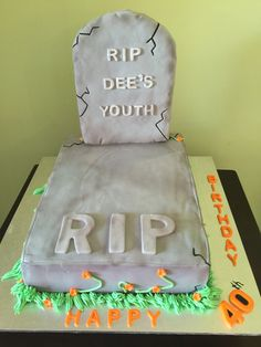 Grave with tombstone. Tombstone made from Rice Krispie (homemade) and covered with fondant. Airbrush highlights on grey fondant.