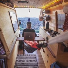 An extra-long Sprinter van is transformed into an incognito home on wheels, with a hammock desk.