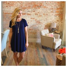 """Navy scalloped shift dress Cute scallop detail along hem and sleeves. Modeling size small.  Nice stretchy fit. 95% polyester 5% spandex. Bust laying flat: S 17"""" M 18"""" L 19"""" length S 34"""" M 35"""" L 36"""". Save when bundling two or more items from my closet,  OS1254222 Dresses"""