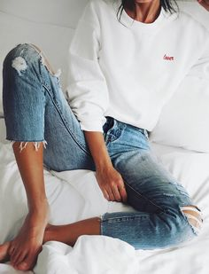 {White pullover and blue denim.}
