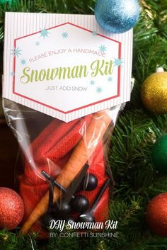 DIY Snowman Kit. Snowman building is really a fun and exciting family winter activity. And for the neighbor gifts, it's thoughtful to make a snowman kit contains everything: wooden bead eyes, a carrot nose, pieces for a mouth, a knit hat and pipe, and more.
