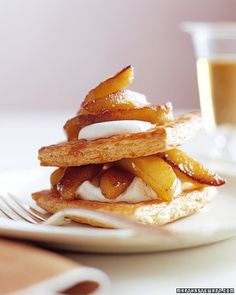 Apple Napoleons,Layers of buttery puff pastry, cinnamon-spiced apples, and whipped cream elevate the concept of the apple tart. You can prepare all the elements of this dessert a day ahead and assemble just before serving.
