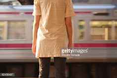 Foto stock : Woman standing at platform,train passing
