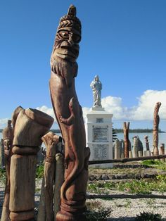 Christian and Kanak symbolism stand side by side on the beach at Baie de St Maurice near Vao on the Isle of Pines, New Caledonia, South Pacific. South Pacific, Statue Of Liberty, Christian, Beach, Travel, Statue Of Liberty Facts, Viajes, Liberty Statue, Seaside