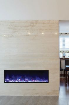 Ventless electric fireplace. Frameless design. Multicolor flame. Optional controllable heat. Remote control.