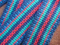 Each guitar strap is one of a kind, woven one at a time on my inkle loom. This strap is combines navy blue as a background for a bright pattern of green, turquoise and red.    The handwoven cotton fabric is smooth, but not slippery, strong and durable, yet soft and comfortable. You will enjoy using it while you are playing because it will conform to fit your body without cutting into your shoulder. It measures 2 wide and adjusts with a slide buckle to fit you, your instrument and your…