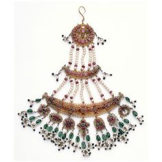 Delhi (made)  Date: c.1853 (made)  Materials and Techniques: Gold filigree with claw settings and pink sapphires, aquamarine with colouring material behind green glass and pearls.