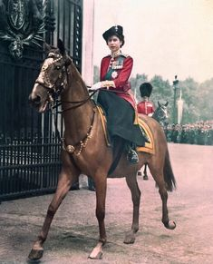 Queen Elizabeth II riding back after the Trooping of the Colour ceremony. Very nice picture for Queen Elizabeth II.