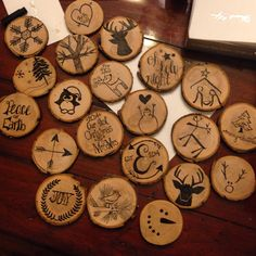 Diy wooden disc ornaments. So easy! Buy wooden discs and sharpie pen from craft store and draw your favorite holiday designs! Place eyehooks at the top of the disc (the easiest part to screw them in Was where the bark was coming off a bit)