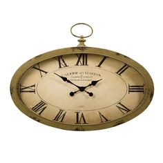 The Sophie oval wall clock features an antiqued sage green finish and looks great with a variety of decor.