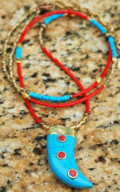 Long and Exotic Southwestern Style Red Glass and Turquoise Tibetan Tusk Pendant Necklace $175 Contact me to purchase kelly@xogallery.com