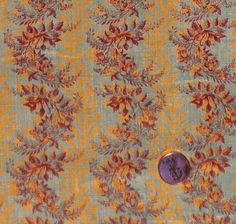 """1830's fabric has a stripe pattern of golden leaves and floral sprays. The leaf stripe is 1/2"""" and the spray is 2-3/4"""" wide."""