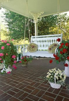 Brick tile front porch with a charming white porch swing. Outdoor Rooms, Outdoor Living, Outdoor Decor, Outdoor Areas, Decoration Shabby, White Porch, Gazebos, Farmhouse Front Porches, Country Porches