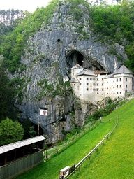 This castle seems cool. Almost tucked into a cave like the ones in coastal Spain.   Predjama Castle, Slovenia