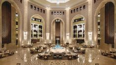 Al Bustan Palace, A Ritz-Carlton Hotel Guests can enjoy listening to live piano and violin music in the hotel's soaring atrium lobby while enjoy cocktails or Afternoon Tea.
