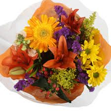 Image result for orange red and pink flower centrepieces
