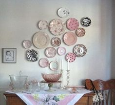 I think this colorful plate wall collage could be really cool with vintage plates.  I think I might arrange them differently though.