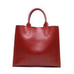 Clean, classic style defines a spacious leather tote that's a commute-ready must-have. Zipper closure Crossbody strap Large handles, extra-large interior capaci
